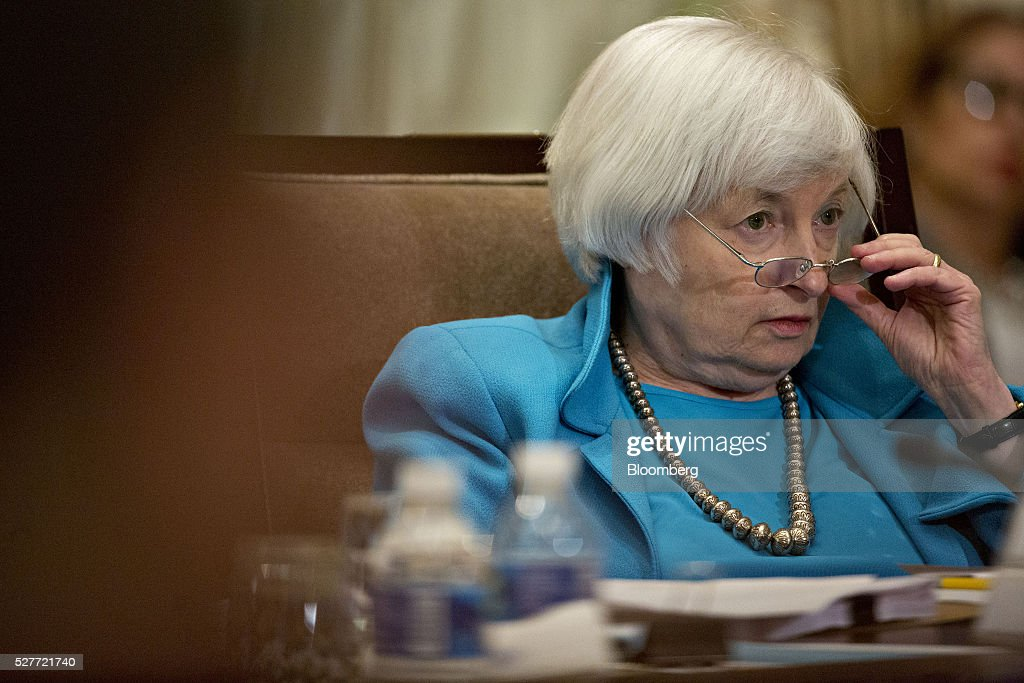 Janet Yellen, chair of the U.S. Federal Reserve, adjusts her glasses during a meeting of the Board of Governors of the Federal Reserve in Washington, D.C., U.S., on Tuesday, May 3, 2016. Hedge funds, insurers and other companies that do business with Wall Street megabanks are poised to pay a price for regulators' efforts to make sure any future collapse of a giant lender doesn't tank the entire financial system. Photographer: Andrew Harrer/Bloomberg via Getty Images