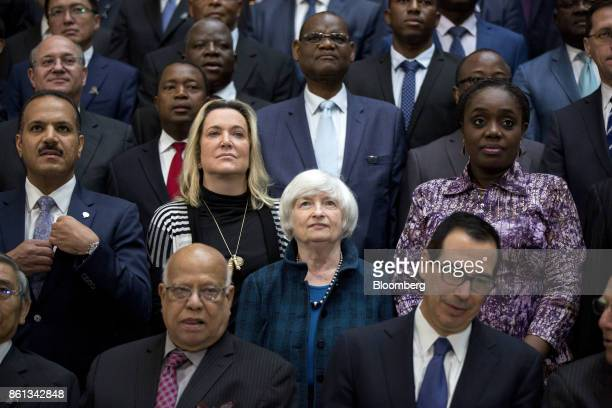 Janet Yellen chair of the US Federal Reserve bottom center stands during an International Monetary Fund governors group photo at the International...
