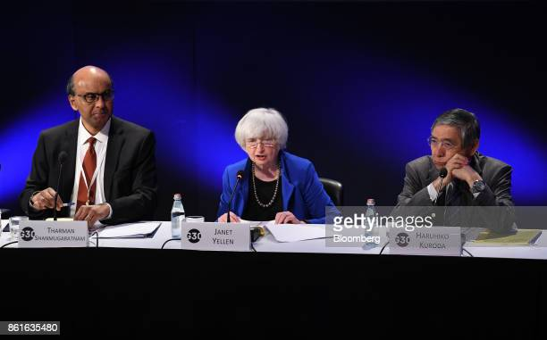 Janet Yellen chair of the US Federal Reserve center speaks as Tharman Shanmugaratnam Singapore's deputy prime minister left and Haruhiko Kuroda...
