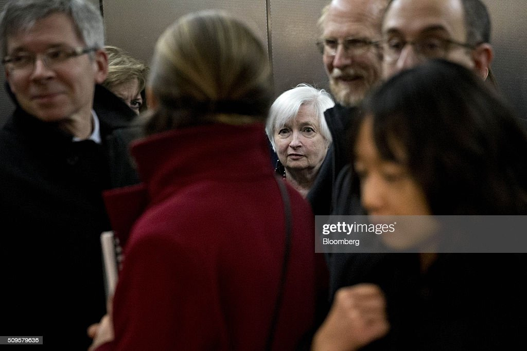 <a gi-track='captionPersonalityLinkClicked' href=/galleries/search?phrase=Janet+Yellen&family=editorial&specificpeople=2731344 ng-click='$event.stopPropagation()'>Janet Yellen</a>, chair of the U.S. Federal Reserve, center, stands in an elevator after a Senate Banking Committee hearing in Washington, D.C., U.S., on Thursday, Feb. 11, 2016. Yellen said the Fed was taking another look at negative interest rates as a potential policy tool if the U.S. economy faltered, a scenario some investors view as a mounting possibility amid a darkening outlook for world growth. Photographer: Andrew Harrer/Bloomberg via Getty Images
