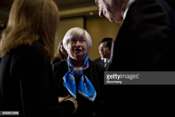 Janet Yellen chair of the US Federal Reserve center talks to attendees before speaking at the Federal Reserve System Community Development Research...