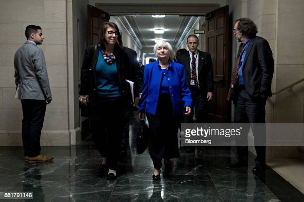 Janet Yellen chair of the US Federal Reserve center walks through the Longworth House Office building after a Joint Economic Committee hearing in...