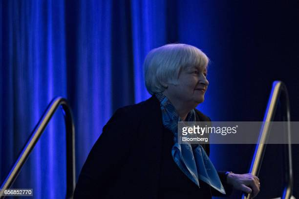 Janet Yellen chair of the US Federal Reserve exits the stage after speaking at the Federal Reserve System Community Development Research Conference...