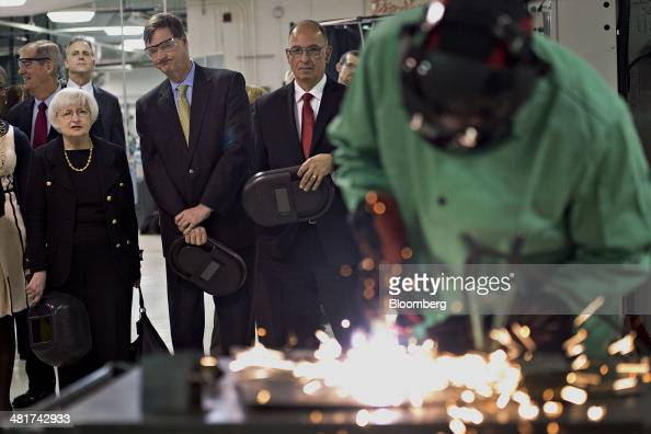 Janet Yellen chair of the US Federal Reserve left and Charles Plosser chairman of the Federal Reserve Bank of Chicago second from left look on as a...