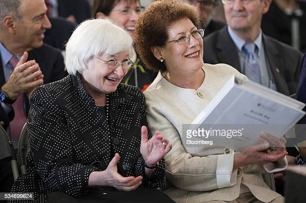Janet Yellen chair of the US Federal Reserve left applauds while sitting next to Lizabeth Cohen dean of the Radcliffe Institute during a Radcliffe...