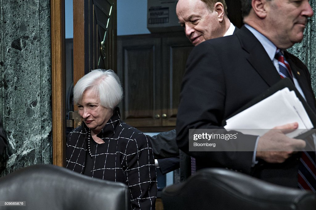 <a gi-track='captionPersonalityLinkClicked' href=/galleries/search?phrase=Janet+Yellen&family=editorial&specificpeople=2731344 ng-click='$event.stopPropagation()'>Janet Yellen</a>, chair of the U.S. Federal Reserve, left, arrives to a Senate Banking Committee hearing with Senator <a gi-track='captionPersonalityLinkClicked' href=/galleries/search?phrase=Richard+Shelby&family=editorial&specificpeople=529578 ng-click='$event.stopPropagation()'>Richard Shelby</a>, a Republican from Alabama and chairman of the Senate Banking Committee, in Washington, D.C., U.S., on Thursday, Feb. 11, 2016. Yellen said yesterday the Federal Reserve still expects to raise interest rates gradually while making it clear that continued market turmoil could throw the central bank off course from the multiple increases that policy makers have forecast for 2016. Photographer: Andrew Harrer/Bloomberg via Getty Images