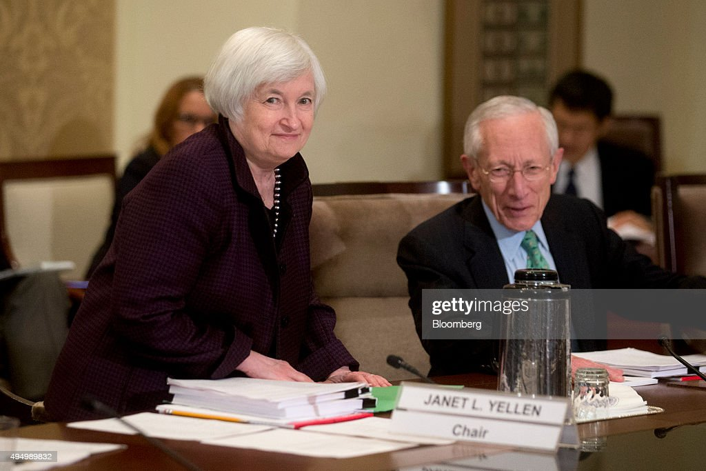 Janet Yellen, chair of the U.S. Federal Reserve, left, arrives to an open meeting of the Board of Governors of the Federal Reserve with Stanley Fischer, vice chairman of the U.S. Federal Reserve, right, in Washington, D.C., U.S., on Friday, Oct. 30, 2015. According to a Federal Reserve rule that's set to be approved today, the largest U.S. banks would face a $120 billion total shortfall of long-term debt under a Fed proposal aimed at ensuring their failure wouldn't hurt the broader financial system. Photographer: Andrew Harrer/Bloomberg via Getty Images