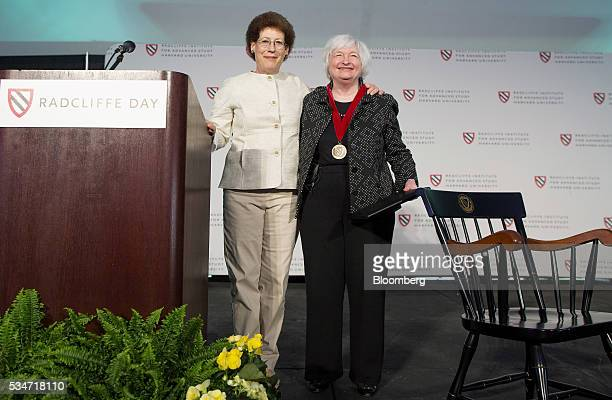 Janet Yellen chair of the US Federal Reserve left stands for a photograph with Lizabeth Cohen dean of the Radcliffe Institute during a Radcliffe Day...