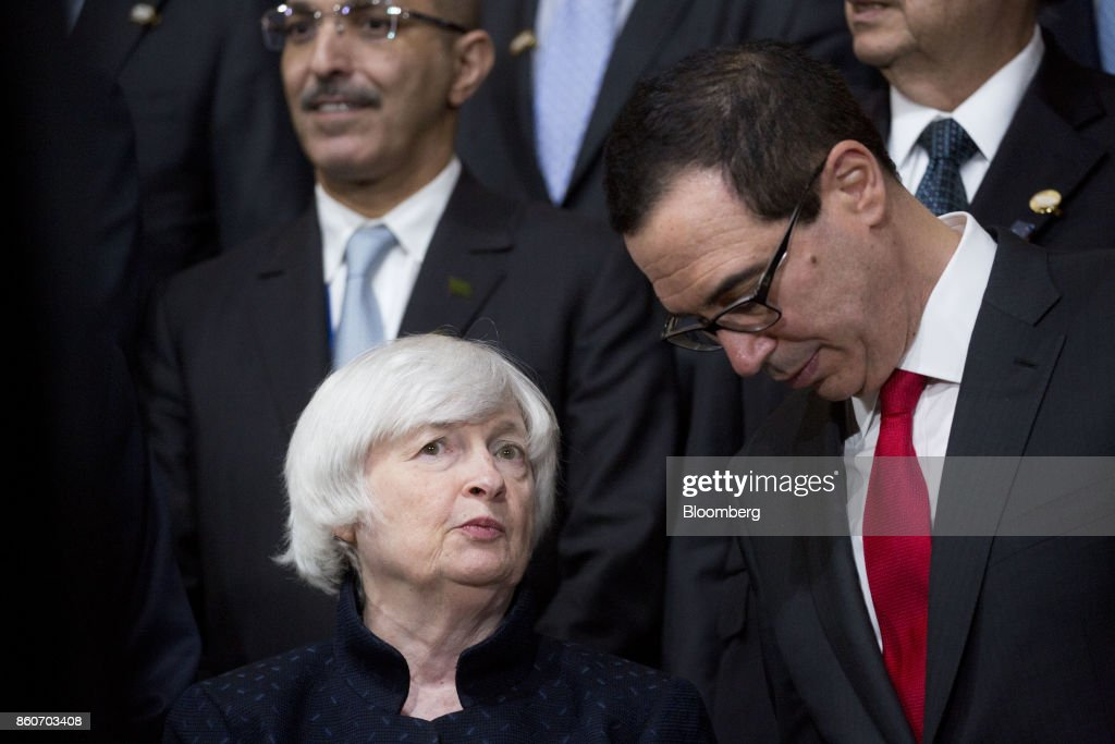 Janet Yellen, chair of the U.S. Federal Reserve, left, talks to Steven Mnuchin, U.S. Treasury secretary, during a Group of 20 (G-20) finance ministers and central bank governors group photo on the sidelines of the International Monetary Fund (IMF) and World Bank Group Annual Meetings in Washington, D.C., U.S., on Thursday, Oct. 12, 2017. Near-term risks to world financial stability have declined since April amid improving macroeconomic conditions and the subsiding risk of emerging-market turmoil, the IMF said in its latest Global Financial Stability Report released yesterday. Photographer: Andrew Harrer/Bloomberg via Getty Images