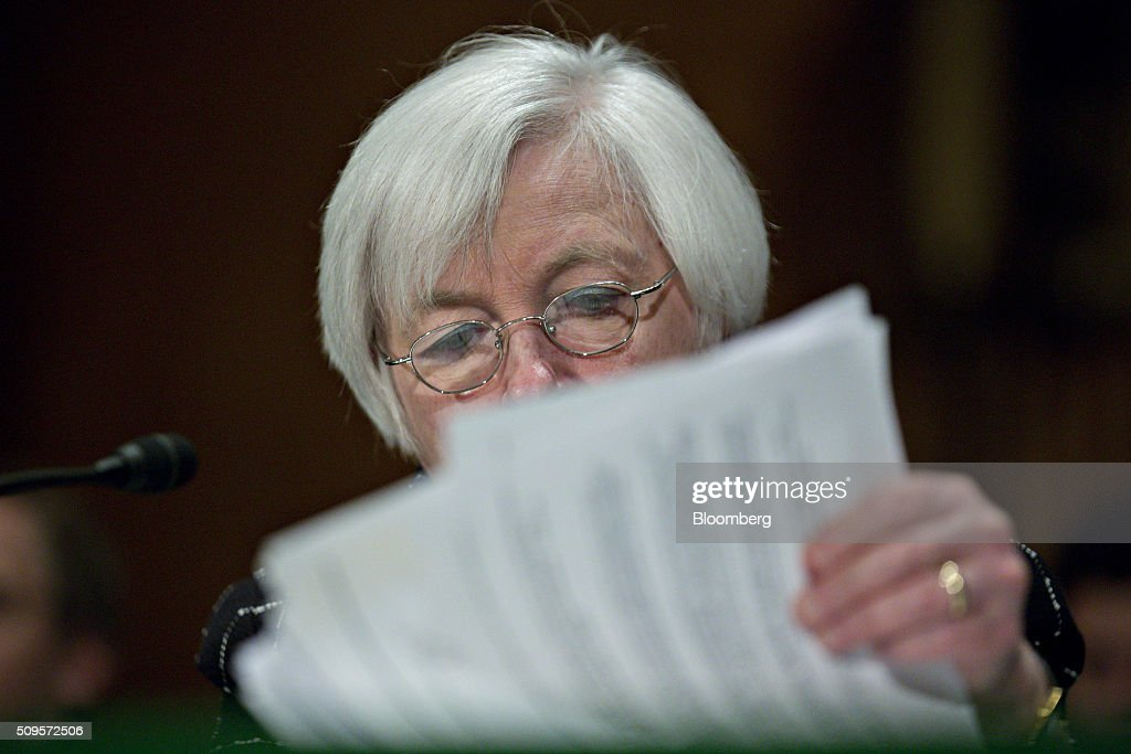 Janet Yellen, chair of the U.S. Federal Reserve, looks through a binder during a Senate Banking Committee hearing in Washington, D.C., U.S., on Thursday, Feb. 11, 2016. Yellen said the Fed was taking another look at negative interest rates as a potential policy tool if the U.S. economy faltered, after central banks in Europe were able to drive borrowing costs below zero. Photographer: Andrew Harrer/Bloomberg via Getty Images