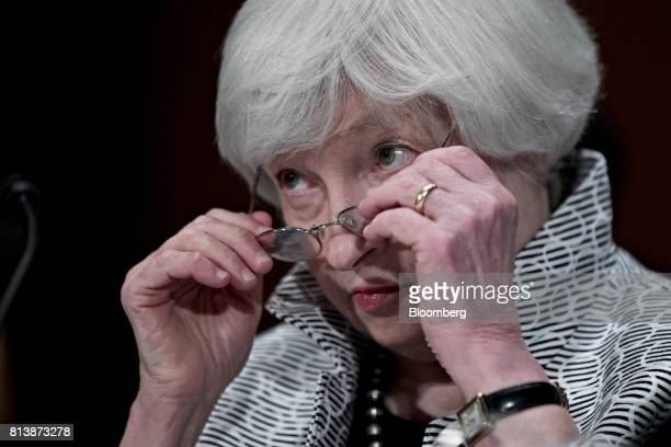 Janet Yellen chair of the US Federal Reserve removes her glasses during a Senate Banking Committee hearing in Washington DC US on Thursday July 13...