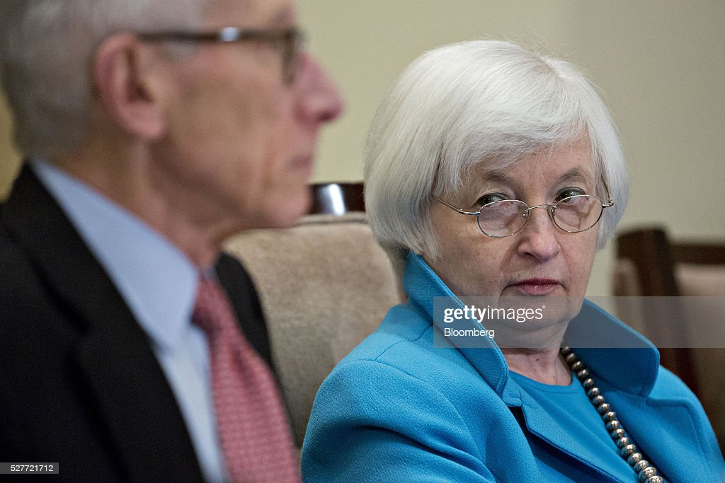 Janet Yellen, chair of the U.S. Federal Reserve, right, and Stanley Fischer, vice chairman of the U.S. Federal Reserve, listen during a meeting of the Board of Governors of the Federal Reserve in Washington, D.C., U.S., on Tuesday, May 3, 2016. Hedge funds, insurers and other companies that do business with Wall Street megabanks are poised to pay a price for regulators' efforts to make sure any future collapse of a giant lender doesn't tank the entire financial system. Photographer: Andrew Harrer/Bloomberg via Getty Images