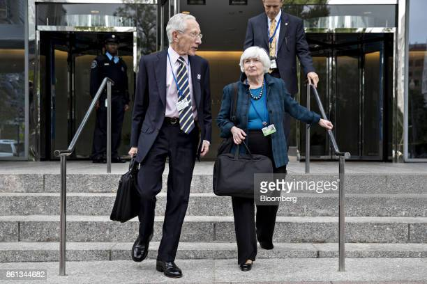 Janet Yellen chair of the US Federal Reserve right and Stanley Fischer former vice chairman of the US Federal Reserve walk out of the International...