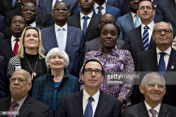 Janet Yellen chair of the US Federal Reserve second left stands next to Steven Mnuchin US Treasury secretary center and Wolfgang Schaeuble Germany's...