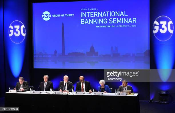 Janet Yellen chair of the US Federal Reserve second right speaks during the Group of Thirty International Banking Seminar in Washington DC US on...