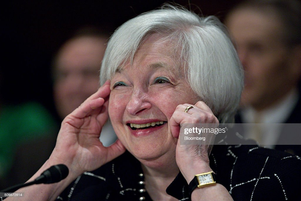 Janet Yellen, chair of the U.S. Federal Reserve, smiles during a Senate Banking Committee hearing in Washington, D.C., U.S., on Thursday, Feb. 11, 2016. Yellen said the Fed was taking another look at negative interest rates as a potential policy tool if the U.S. economy faltered, after central banks in Europe were able to drive borrowing costs below zero. Photographer: Andrew Harrer/Bloomberg via Getty Images