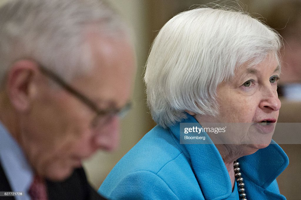 Janet Yellen, chair of the U.S. Federal Reserve, speaks as Stanley Fischer, vice chairman of the U.S. Federal Reserve, left, listens during a meeting of the Board of Governors of the Federal Reserve in Washington, D.C., U.S., on Tuesday, May 3, 2016. Hedge funds, insurers and other companies that do business with Wall Street megabanks are poised to pay a price for regulators' efforts to make sure any future collapse of a giant lender doesn't tank the entire financial system. Photographer: Andrew Harrer/Bloomberg via Getty Images