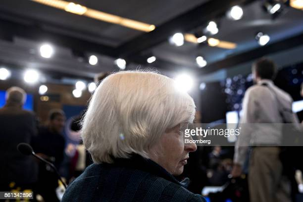 Janet Yellen chair of the US Federal Reserve talks to an attendee during an International Monetary Fund Committee plenary session at the...
