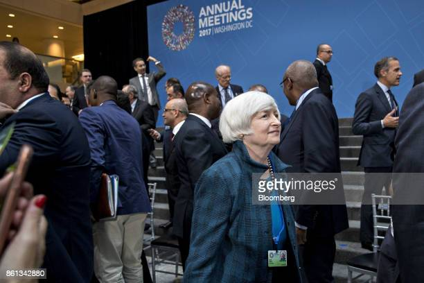 Janet Yellen chair of the US Federal Reserve walks to an International Monetary Fund Committee plenary session at the International Monetary Fund and...