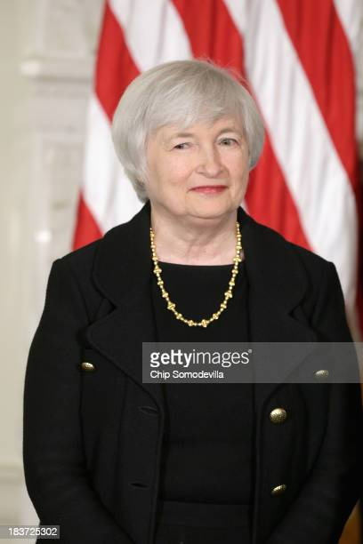 Janet Yellen listens as US President Barack Obama speaks during a press conference to nominate her to head the Federal Reserve in the State Dining...