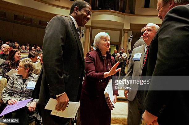 Janet Yellen president of the Federal Reserve Bank of San Francisco center chats with attendees before giving a speech at the University of San...