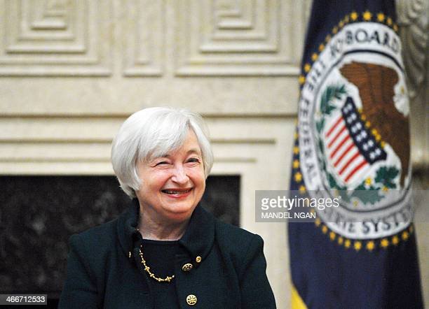 Janet Yellen smiles after taking the oath of office as Chairman of the Board of Governors of the Federal Reserve System February 3 2014 at the Eccles...