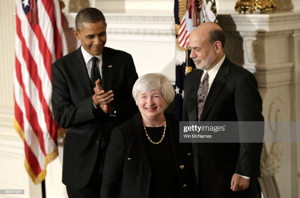 <a gi-track='captionPersonalityLinkClicked' href=/galleries/search?phrase=Janet+Yellen&family=editorial&specificpeople=2731344 ng-click='$event.stopPropagation()'>Janet Yellen</a> smiles as U.S. President <a gi-track='captionPersonalityLinkClicked' href=/galleries/search?phrase=Barack+Obama&family=editorial&specificpeople=203260 ng-click='$event.stopPropagation()'>Barack Obama</a> (L) and current Chairman of the Federal Reserve Ben Bernake (R) applaude her during a press conference to nominate Yellen to head the Federal Reserve in the State Dining Room at the White House on October 9, 2013 in Washington, DC. If confirmed Yellen would be the first woman to lead the worlds most powerful central bank, replacing <a gi-track='captionPersonalityLinkClicked' href=/galleries/search?phrase=Ben+Bernanke&family=editorial&specificpeople=568098 ng-click='$event.stopPropagation()'>Ben Bernanke</a>. Yellen was appointed vice chair in October 2010. She was president and CEO of the Federal Reserve Bank of San Francisco from 2004 to 2010 and also served as chair of the Council of Economic Advisors from 1997 to 1999.