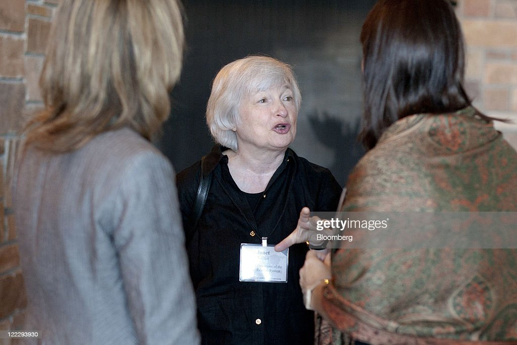 <a gi-track='captionPersonalityLinkClicked' href=/galleries/search?phrase=Janet+Yellen&family=editorial&specificpeople=2731344 ng-click='$event.stopPropagation()'>Janet Yellen</a>, vice chair of the U.S. Federal Reserve Board of Governors, center, speaks to colleagues during an economic symposium sponsored by the Kansas City Federal Reserve Bank in Moran, Wyoming, U.S., on Saturday, Aug. 27, 2011. Federal Reserve Chairman Ben S. Bernanke said at the symposium yesterday that the central bank still has tools to stimulate the economy without providing details or signaling when or whether policy makers might deploy them. Photographer: Daniel Acker/Bloomberg via Getty Images