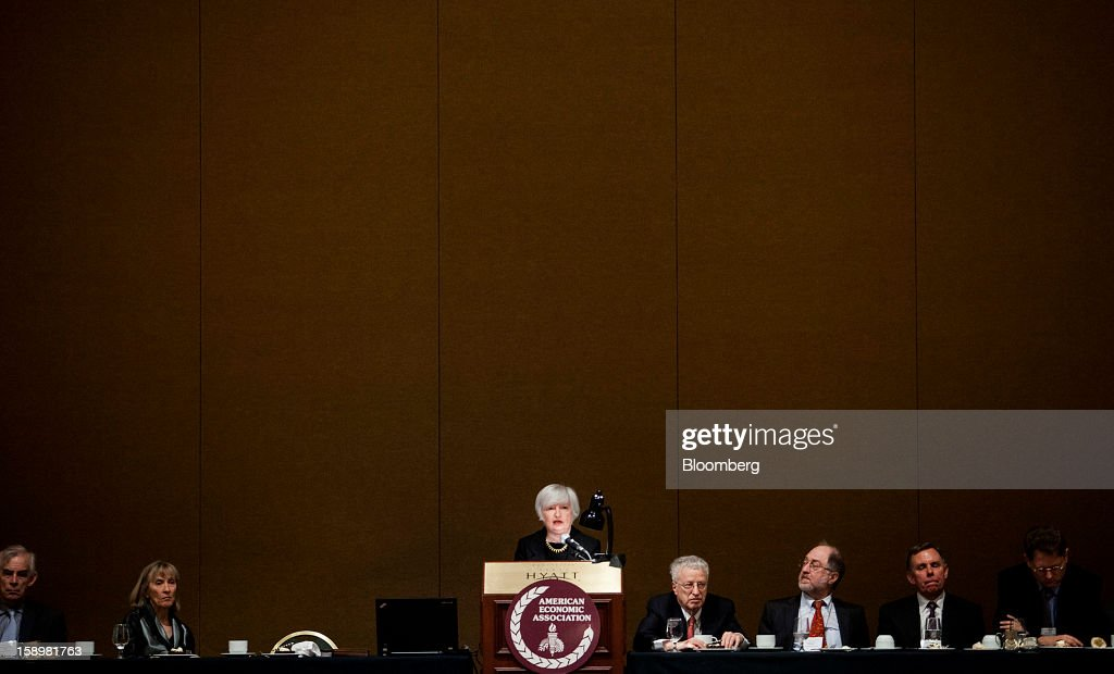 Janet Yellen, vice chairman of the U.S. Federal Reserve, center, speaks at the American Economic Association's annual meeting in San Diego, California, U.S., on Friday, Jan. 4, 2013. Yellen said financial markets should be regulated more tightly to reduce the risk of 2008-like credit crises. Photographer: Sam Hodgson/Bloomberg via Getty Images