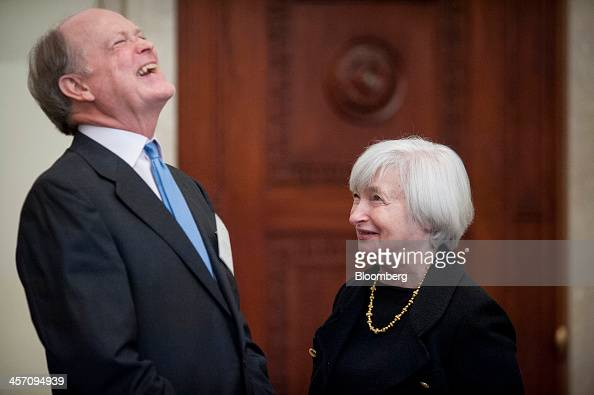 Janet Yellen vice chairman of the US Federal Reserve right laughs with Charles Plosser president of the Federal Reserve Bank of Philadelphia at an...