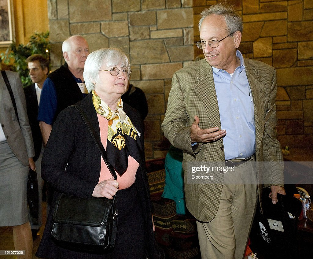 Janet Yellen, vice chairman of U.S. Federal Reserve, left, talks with Donald L. Kohn, a senior fellow at the Brookings Institute and former vice chairman at the Fed, as they leave the morning session at the economic symposium sponsored by the Kansas City Federal Reserve Bank at the Jackson Lake Lodge in Moran, Wyoming, U.S., on Friday, Aug. 31, 2012. U.S. Federal Reserve Chairman Ben S. Bernanke, decrying the suffering caused by unemployment of more than 8 percent and defending his unprecedented policies, said in a speech today at the symposium that more bond purchases are an option as central bankers weigh further steps to spur growth. Photographer: Price Chambers/Bloomberg via Getty Images