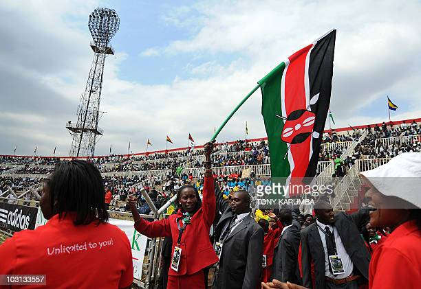 Janeth Jepkosgei Olympic Silver Medalist in 2008 waves a Kenya's flag as the leads the Kenya squad to parade on July 28 2010 during the opening...