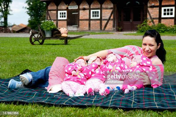 Janett Mehnert and her quadruplets Sophie Jasmin Laura and Kim pose for a picture during their first holiday at a family farm on June 20 2012 in...