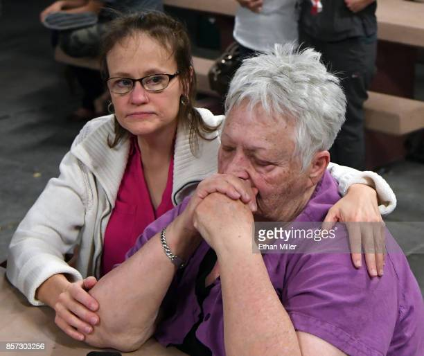 Janetta Gray and Maxine Johnson both of Nevada attend a prayer vigil held at Mountain Crest Park for the victims of Sunday night's shooting on...