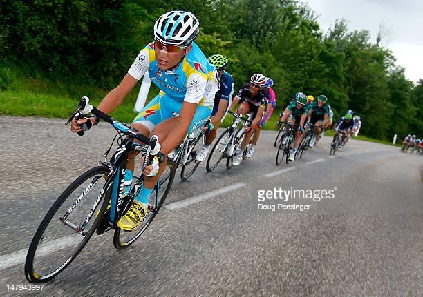 Janez Brajkovic of Slovenia tries to chase back to the peloton after being caught by a crash with 25km to the finish of stage six of the 2012 Tour de...