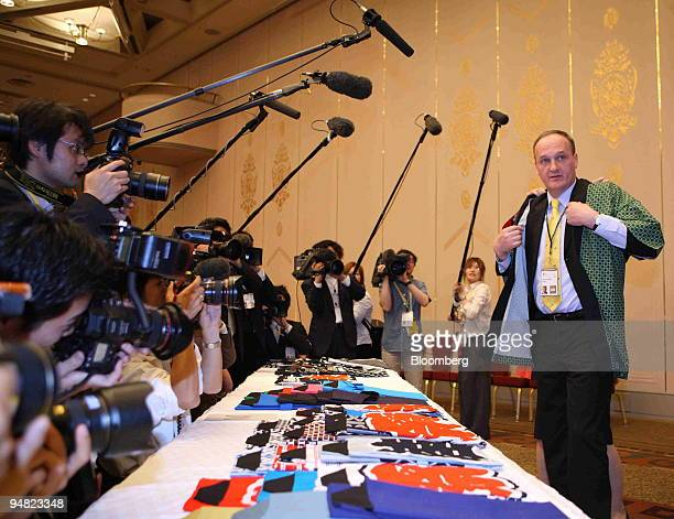 Janez Podobnik Slovenia's environment minister is surrounded by the media as he wears a traditional happi coat before a group photo session at the G8...
