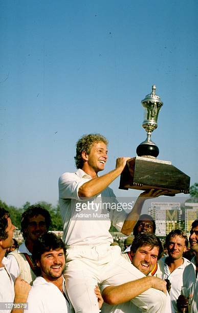 David Gower of England holds the trophy aloft after the Fifth Test against India at Green Park in Kanpur India The match ended in a draw Mandatory...