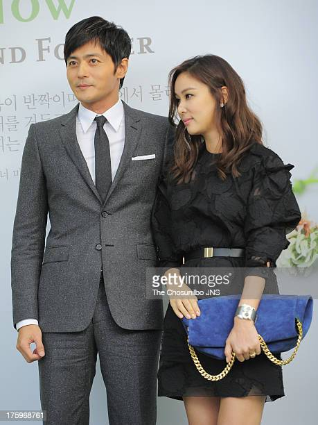 Jang DongGun and wife Ko SoYoung attend Lee ByungHun and Lee MinJung's wedding at Grand Hyatt Hotel on August 10 2013 in Seoul South Korea