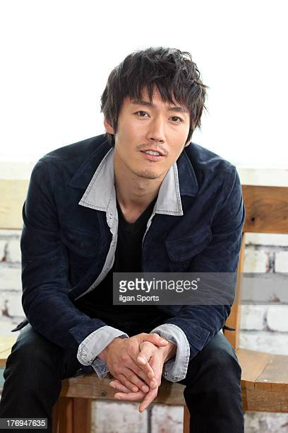 Jang Hyuk poses for photographs on August 13 2013 in Seoul South Korea