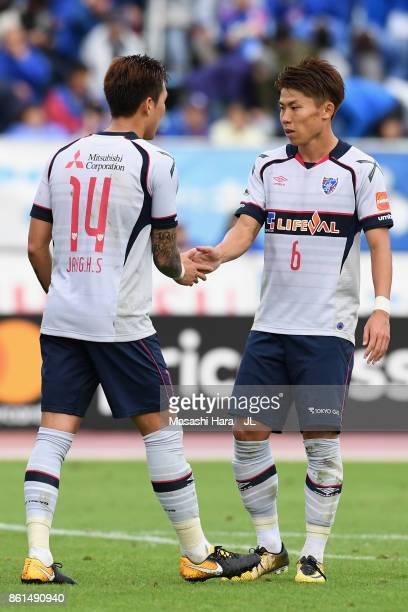 Jang Hyun Soo and Kosuke Ota of FC Tokyo shake hands after the 11 draw in the JLeague J1 match between Ventforet Kofu and FC Tokyo at Yamanashi Chuo...