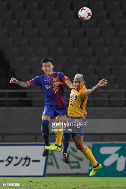 Jang Hyun Soo of FC Tokyo and Crislan of Vegalta Sendai compete for the ball during the JLeague J1 match between FC Tokyo and Vegalta Sendai at...