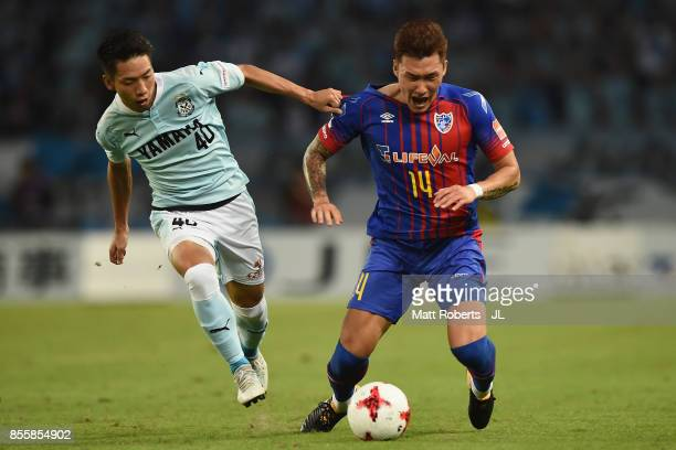 Jang Hyun Soo of FC Tokyo and Hayao Kawabe of Jubilo Iwata compete for the ball during the JLeague J1 match between FC Tokyo and Jubilo Iwata at...