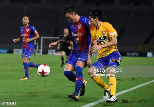Jang Hyun Soo of FC Tokyo controls the ball under pressure of Yoshihiro Nakano of Vegalta Sendai during the JLeague J1 match between FC Tokyo and...