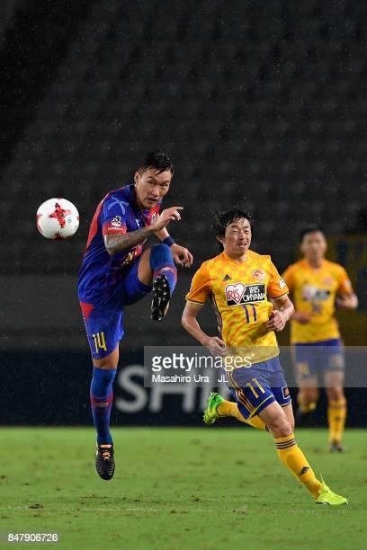 Jang Hyun Soo of FC Tokyo controls the ball under pressure of Naoki Ishihara of Vegalta Sendai during the JLeague J1 match between FC Tokyo and...