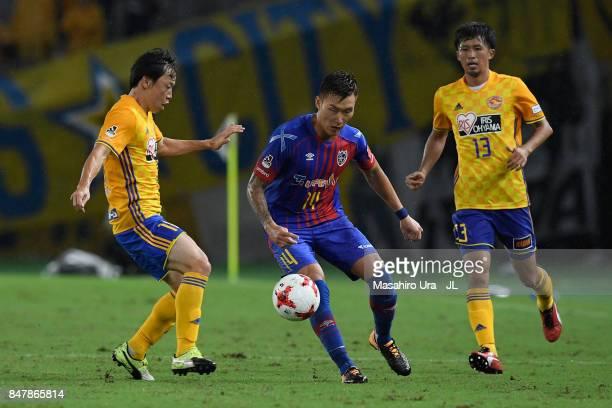Jang Hyun Soo of FC Tokyo controls the ball under pressure of Ryang Yong Gi and Yasuhiro Hiraoka of Vegalta Sendai during the JLeague J1 match...