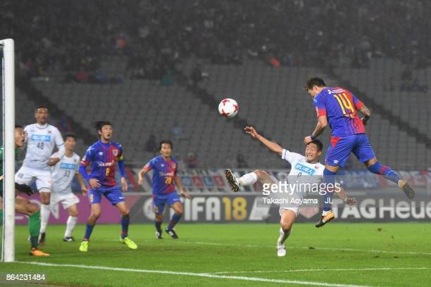 Jang Hyun Soo of FC Tokyo heads the ball to score his side's first goal during the JLeague J1 match between FC Tokyo and Consadole Sapporo at...