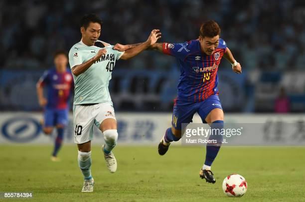 Jang Hyun Soo of FC Tokyo is challenged by Hayao Kawabe of Jubilo Iwata during the JLeague J1 match between FC Tokyo and Jubilo Iwata at Ajinomoto...