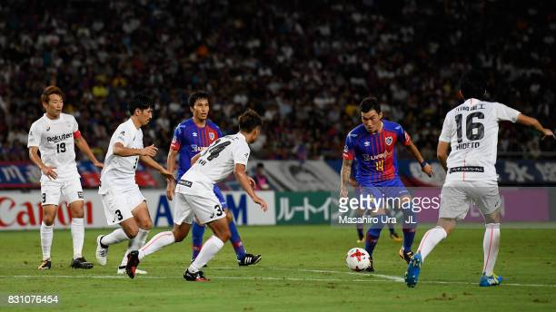 Jang Hyun Soo of FC Tokyo takes on Vissel Kobe defense during the JLeague J1 match between FC Tokyo and Vissel Kobe at Ajinomoto Stadium on August 13...