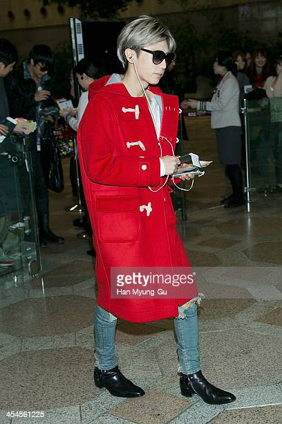Jang HyunSeung of South Korean boy band Beast is seen on departure at Gimpo International Airport on December 9 2013 in Seoul South Korea