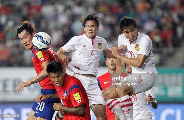 Jang HyunSoo and Suk HyunJun of South Korea compete for the ball with Phommapanya Saynakhonevieng and Sayavutthi Khampheng of Laos during the 2018...